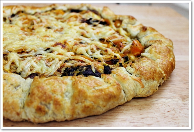 Butternut Squash And Cabbage Galette - Butternut Squash is roasted with cabbage and onions, then scattered over a flaky, buttery crust that is generously topped with Jarlsberg cheese! www.mind-over-batter.com
