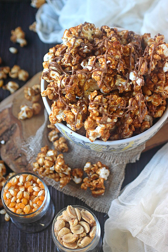 Peanut Butter Caramel Corn!! Popped corn kernels are drowned in a delicious caramel sauce mixed with a healthy dose of peanut butter and peanuts. Perfect for movie night crunchy snackin'!  www.mind-over-batter.com