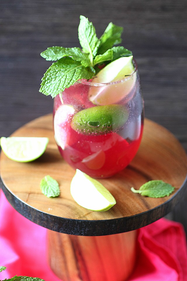 Cuba's national cocktail just got a makeover! Intensely floral, a lightly tart - This Lavender Blueberry Mojito is mixed with a lavender blueberry infused simple syrup, mint, and a generous pour of dark rum! {mind-over-batter.com}
