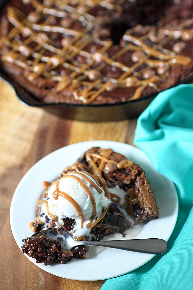 A dark chocolate chip brownie layer sits atop a sweetened flaked coconut chocolate chip cookie layer in this Brookie Skillet Cookie. Left slightly under baked and served with vanilla ice cream - This Brookie Skillet Cookie is a gooey treat to enjoy repeatedly and often! -- mind-over-batter.com