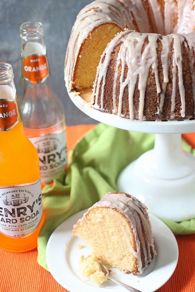 This Hard Orange Soda Bundt Cake gets its sass from vanilla infused citrus, and its springy fluffiness from a boozy carbonated hard orange soda. Glazed with more vanilla infused citrus, this bundt cake is perfect for popping up at a friend's house for a cool afternoon of girly chatter! www.mind-over-batter.com