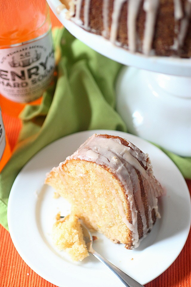 This Hard Orange Soda Bundt Cake gets its sass from vanilla infused citrus, and its springy fluffiness from a boozy carbonated hard orange soda. Glazed with more vanilla infused citrus, this bundt cake is perfect for popping up at a friend's house for a cool afternoon of girly chatter!
