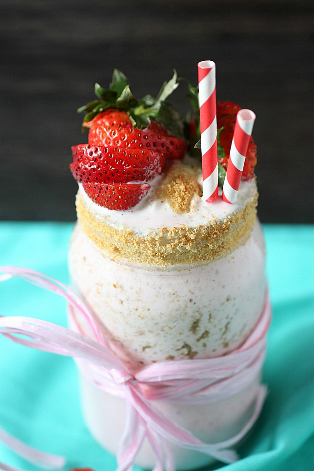 It's hot out. Let's get down with this Strawberry Cream Cheese Milkshake! Creamy vanilla bean ice cream is blended with fresh strawberries, tangy cream cheese, and served with crushed graham crackers. It's a frozen treat you must sip all summer long! {mind-over-batter.com}