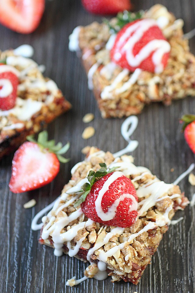 Seasonal Strawberry Vanilla Jam is sandwiched between two delightful almond oat crumble layers! These Strawberry Almond Crumble Bars make a perfect breakfast or afternoon tea snack! -- mind-over-batter.com