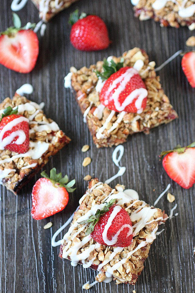 Seasonal Strawberry Vanilla Jam is sandwiched between two delightful almond oat crumble layers! These Strawberry Almond Crumble Bars make a perfect breakfast or afternoon tea snack!-- mind-over-batter.com