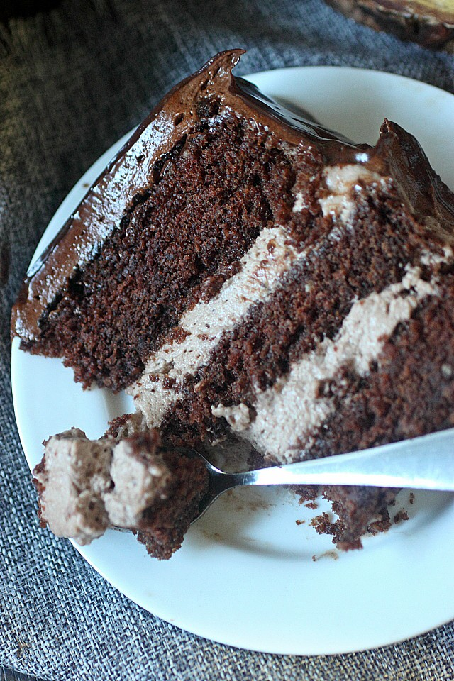 Cakes just got boozy, y'all!! Creamy Baileys Irish Cream Mousse is sandwiched between moist layers of rich chocolate cake, frosted with a sweet heavy cream lightened chocolate buttercream, and glazed with a semi-sweet ganache. One bite and you're a goner!!  www.mind-over-batter.com