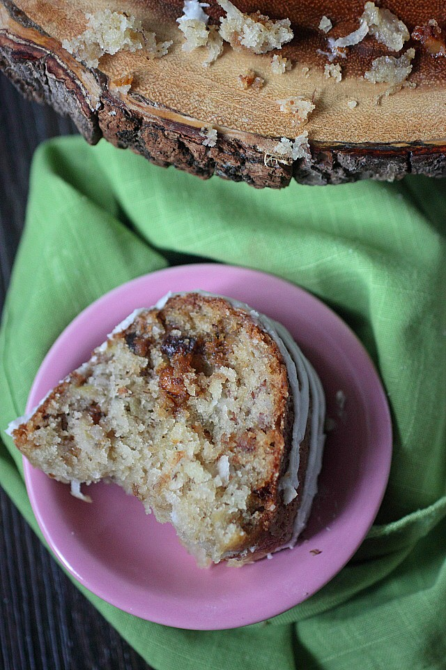 Baked with ripe bananas, sweetened flaked coconut, and candied walnuts for a delightful caramel crunch - This Banana Coconut Crunch Cake is a new twist on every day banana bread! - www.mind-over-batter.com
