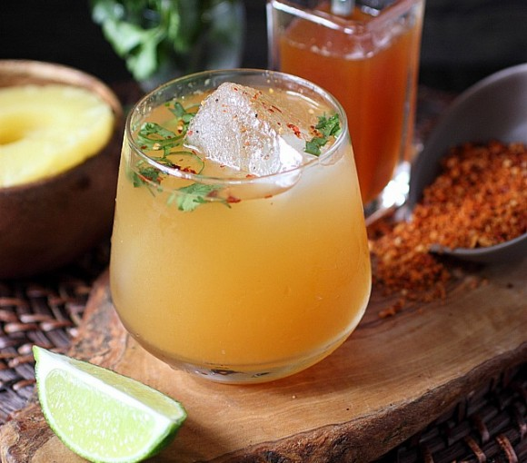 Welcome to your weekend cocktail situation! I paired a spicy roasted pineapple syrup with tequila, fresh pineapple juice, tart lime, and super herbaceous cilantro! Some like it hot and this Spicy Roasted Pineapple Cilantro Cocktail has that lil' bit o' heat you crave! www.mind-over-batter.com