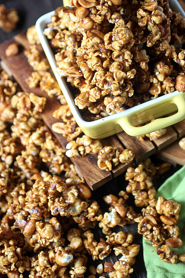 Have ripe bananas? Give this Banana Maple Caramel Corn a try! A buttery brown sugar caramel is blended with ripe bananas, banana liqueur, and maple syrup. Poured over freshly popped popcorn and baked over low heat, this sweet and crunchy treat is the perfect snack food! www.mind-over-batter.com