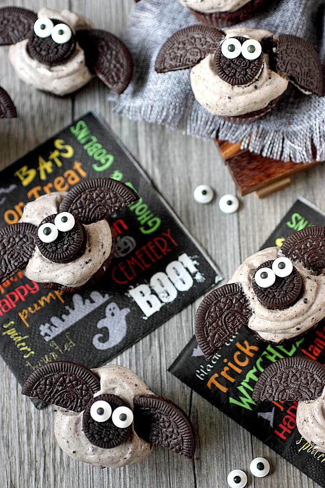 Halloween treats just got a cuter with these Chocolate Cookies –N- Cream Mini Bat Cupcakes! Moist mini chocolate cupcakes are frosted with a lip-smacking cookies –n – cream frosting and topped with adorable Oreo cookie bats! Take them to your next Halloween party. They are guaranteed to be hit! www.mind-over-batter.com