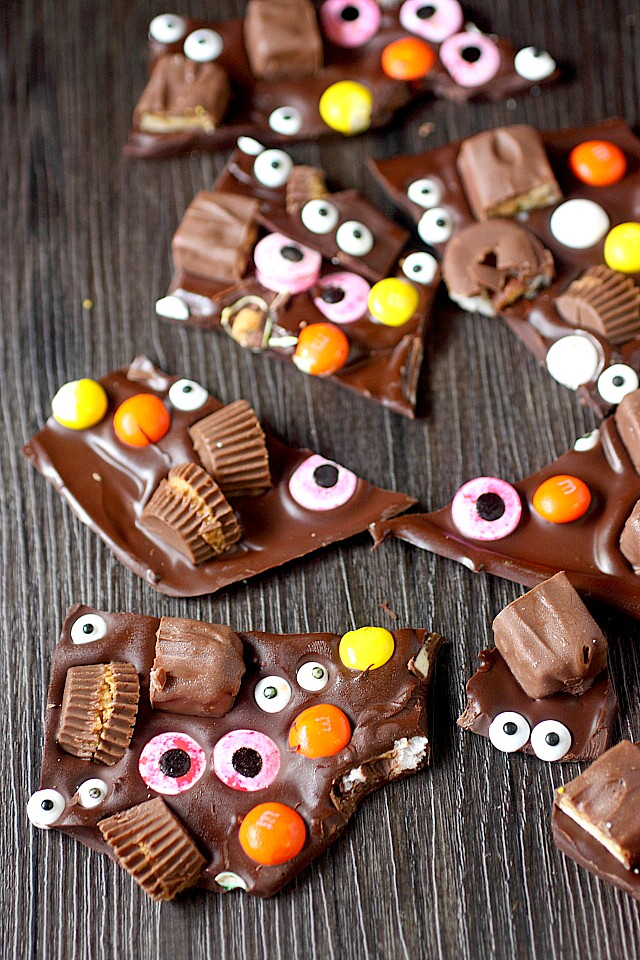 How FUN is this Halloween bark?! Sometimes one candy bar isn't enough. Sometimes you need several fun size pieces of chocolate pressed into melted chocolate. And since we're celebrating Halloween – Candy eyes – Because you gotta feel like somebody's watching you! www.mind-over-batter.com