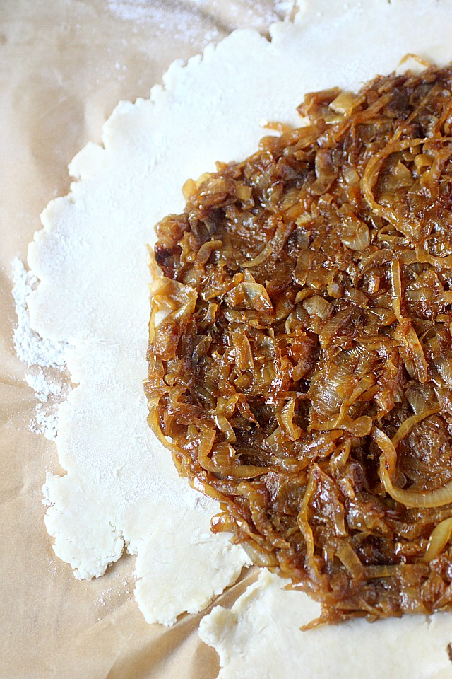 Picture this: A cheesy, flaky pie dough. Are you with me so far? This cheesy dough is scattered with onions caramelized with butter and bourbon – Then topped with gruyere cheese. All these goodies are in this Caramelized Onion & Gruyère Galette. A rustic, easy to make pie with so much flavor – Stopping at one slice will prove near impossible! www.mind-over-batter.com