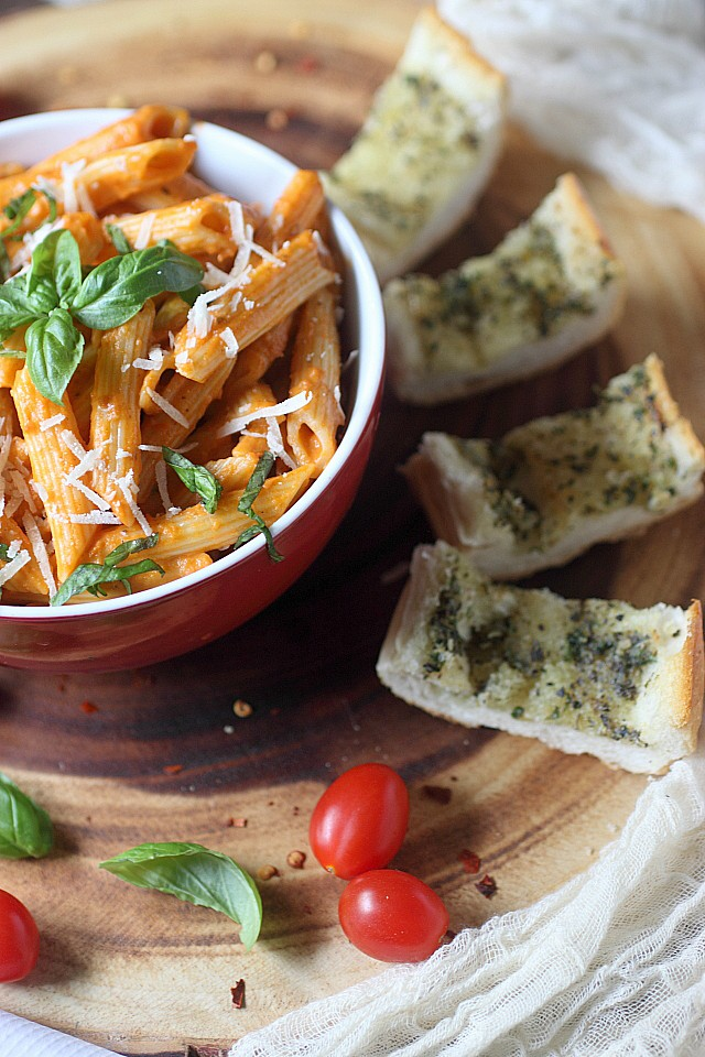 Spicy... Cheesy... Boozy... Robust. This Penne Alla Vodka is all this and more! Make this for dinner tonight! www.mind-over-batter.com