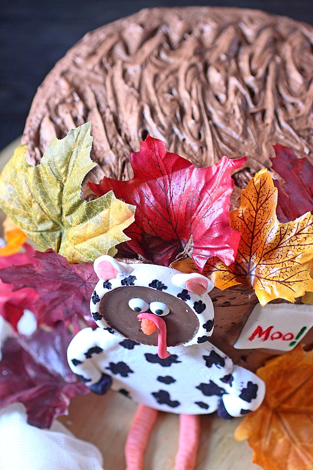 Layers of super moist chocolate cake are liberally filled with a luscious pumpkin filling, and decorated with the CUTEST turkey disguised as a cow! Shh.. Don't narc on the turkey! This cake is fun to make, and even more fun to eat! www.mind-over-batter.com